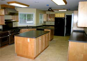 Large Kitchen with Maui Corian Countertops and Island