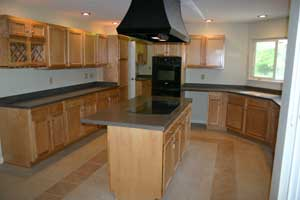 Large Kitchen with Maui Corian Countertops